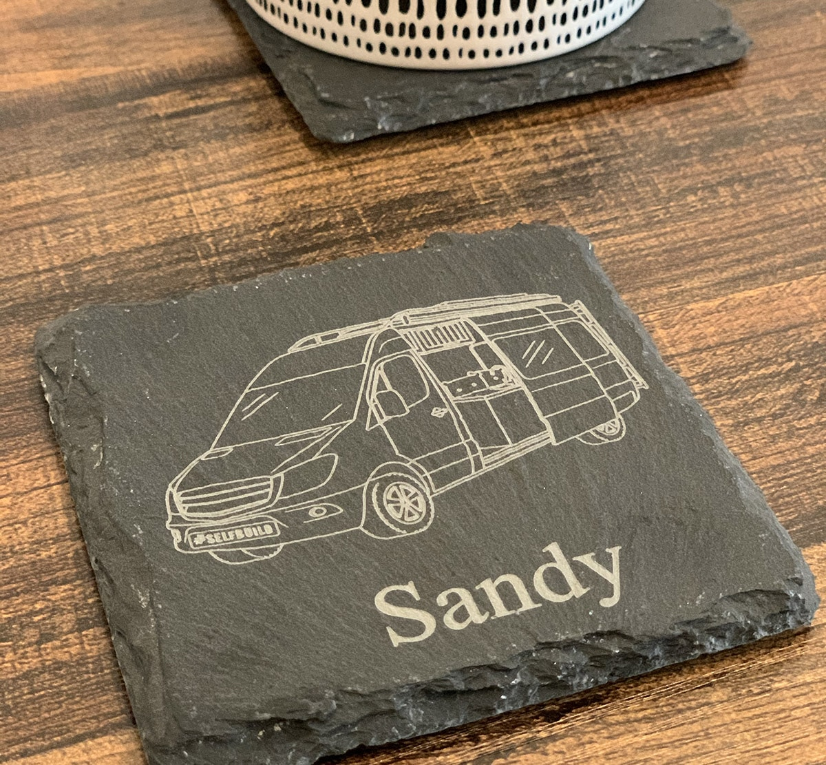 personalised camper van slate coaster on a table with a coffee cup