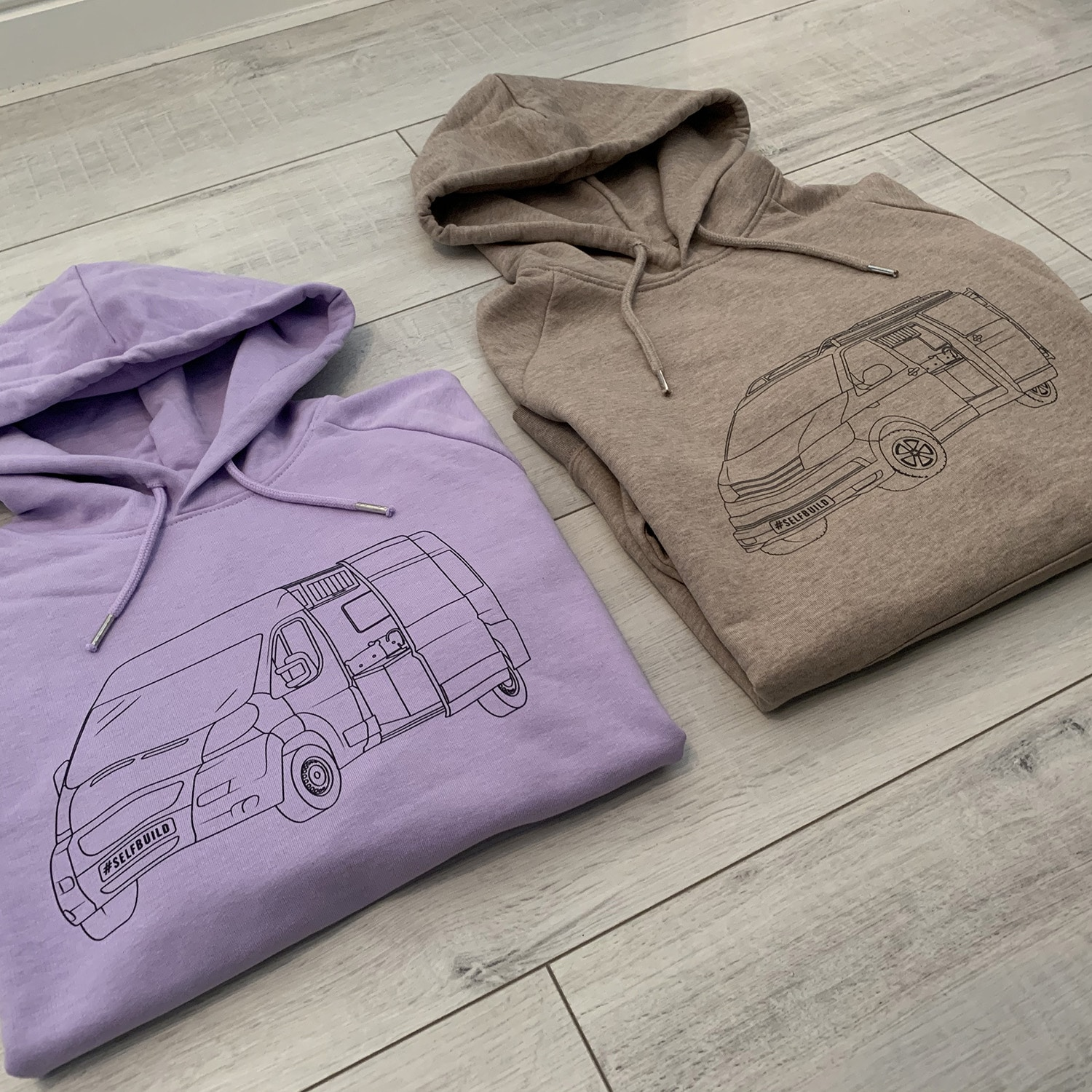 Both our womens campervan hoodie colours of roaming sand and wild lavender showing a relay campervan and t6 transporter campervan - truly great camper van gift