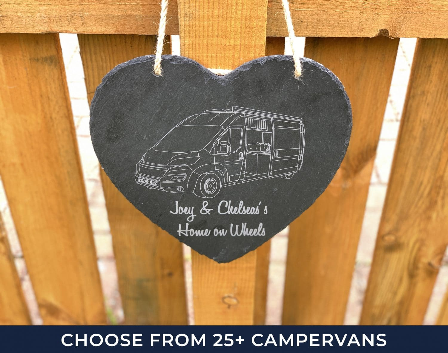 campervan wall art heart sign hanging on an outdoor bit of wood which is being gifted to a vw owner
